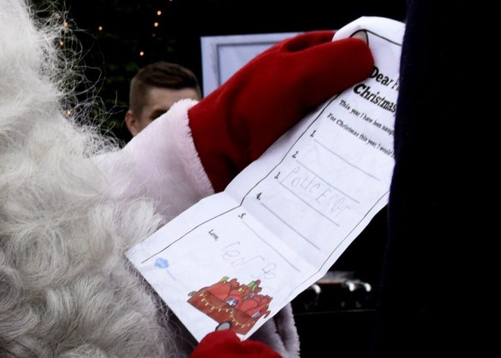 Prince William hands over a wish list by his son Prince George to Santa Claus as he visits the Esplanade Park and the Manta's Market winter fair in Helsinki, Finland, on Nov. 30, 2017.