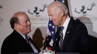 Detroit Mayor Mike Duggan, left, greets Vice President Joe Biden at a ceremony honoring 15 Detroit entrepreneurs, Tuesday, Jan. 10, 2017, in Detroit. The entrepreneurs earned Motor City Match grants to open or expand their business in the city. (AP Photo/Carlos Osorio)