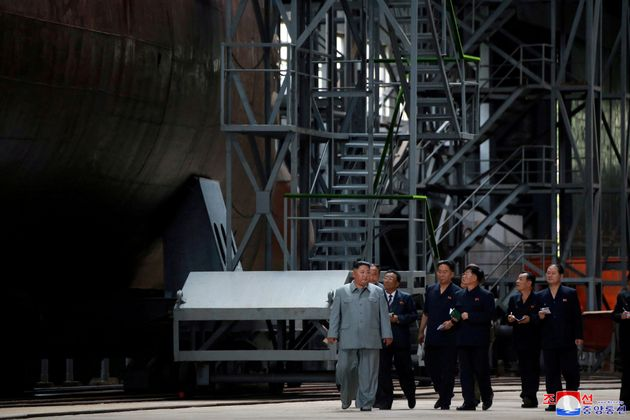 North Korean leader Kim Jong Un visits a submarine factory in an undisclosed location in this undated...