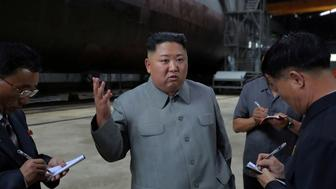 North Korean leader Kim Jong Un visits a submarine factory in an undisclosed location, North Korea, in this undated picture released by North Korea's Central News Agency (KCNA) on July 23, 2019.    KCNA via REUTERS    ATTENTION EDITORS - THIS IMAGE WAS PROVIDED BY A THIRD PARTY. REUTERS IS UNABLE TO INDEPENDENTLY VERIFY THIS IMAGE. NO THIRD PARTY SALES. SOUTH KOREA OUT. NO COMMERCIAL OR EDITORIAL SALES IN SOUTH KOREA.