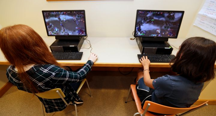 "Claire Hofstra, left, and Kaila Morris play ""Heroes of the Storm,"" at Hathaway Brown School, Wednesday, July 10, 2019, in Sha"