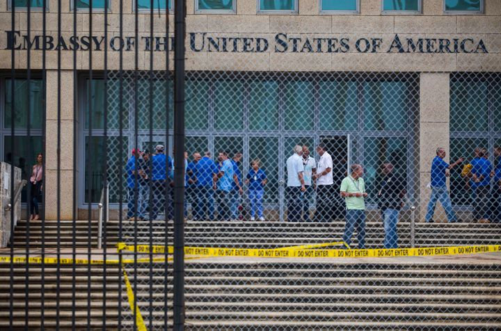 Staff stand within the United States embassy facility in Havana, Cuba, Friday, Sept. 29, 2017.