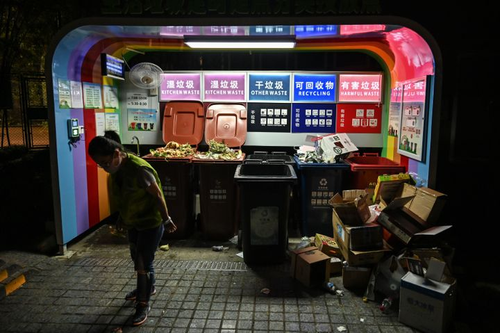 A color-coded trash sorting station in a residential area of Shanghai. New rules for separating different types of trash went into effect in the city on July 1. It's China's most ambitious garbage separation and recycling program ever.