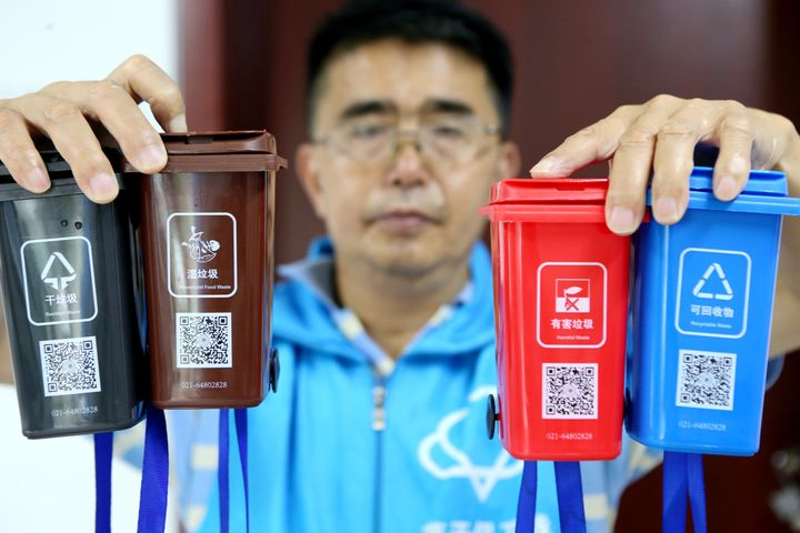Miniature replicas of Shanghai's new waste-sorting bins were used to help locals learn the rules.