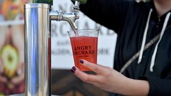 NEW YORK, NY - OCTOBER 13: A bartender pours Angry Orchard during the Food Network's rooftop birthday party hosted by Alton Brown, Giada De Laurentiis, Bobby Flay and Ina Gart at Pier 92 on October 13, 2018 in New York City.  (Photo by Noam Galai/Getty Images for NYCWFF)