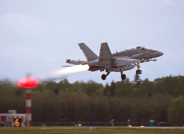 An RCAF CF-18 takes off from CFB Bagotville, Que. on June 7,