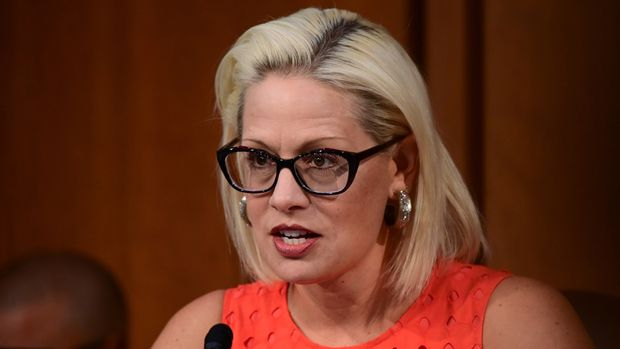 """Senator Kyrsten Sinema (D-AZ) questions David Marcus, head of Facebook's Calibra (digital wallet service), during testimony before a Senate Banking, Housing and Urban Affairs Committee hearing on """"Examining Facebook's Proposed Digital Currency and Data Privacy Considerations"""" on Capitol Hill in Washington, U.S., July 16, 2019. REUTERS/Erin Scott"""