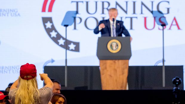 President Donald Trump acknowledges a person in the audience while speaking at Turning Point USA Teen Student Action Summit at the Marriott Marquis in Washington, Tuesday, July 23, 2019. (AP Photo/Andrew Harnik)