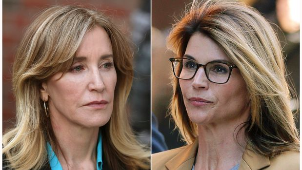 This combination photo shows actresses Felicity Huffman, left, and Lori Loughlin outside of federal court in Boston on Wednesday, April 3, 2019, where they face charges in a nationwide college admissions bribery scandal. (AP Photo/Charles Krupa, left, Steven Senne)