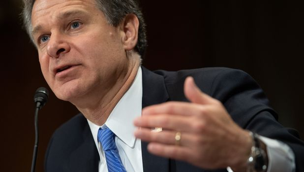 "FBI Director Christopher Wray testifies on July 23, 2019, during a full committee hearing on the ""Oversight of the Federal Bureau of Investigation"" at the US Congress in Washington, DC. (Photo by SAUL LOEB / AFP)        (Photo credit should read SAUL LOEB/AFP/Getty Images)"