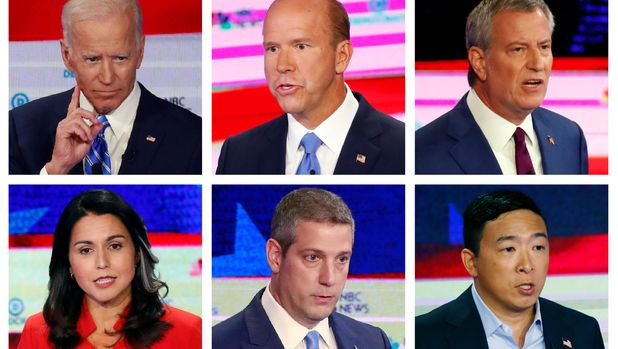 This combination of June 26 and 27, 2019 photos from the first round of Democratic debates in Miami shows, top row from left, former Vice President Joe Biden, former Maryland Congressman John Delaney and New York City Mayor Bill de Blasio; bottom row from left, Hawaii Rep. Tulsi Gabbard, Ohio Rep. Tim Ryan and entrepreneur Andrew Yang. On Friday, July 5, 2019, The Associated Press reported on stories circulating online incorrectly asserting not a single Democratic presidential candidate wore an American flag lapel pin during the first round of Democratic debates. (AP Photo/Wilfredo Lee)