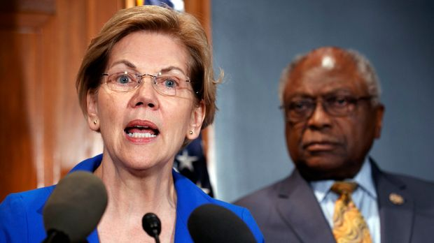 Sen. Elizabeth Warren, D-Mass., left, and Rep. Jim Clyburn, D-S.C., speak about a bill to cancel student loan debt, Tuesday, July 23, 2019, on Capitol Hill in Washington. (AP Photo/Jacquelyn Martin)
