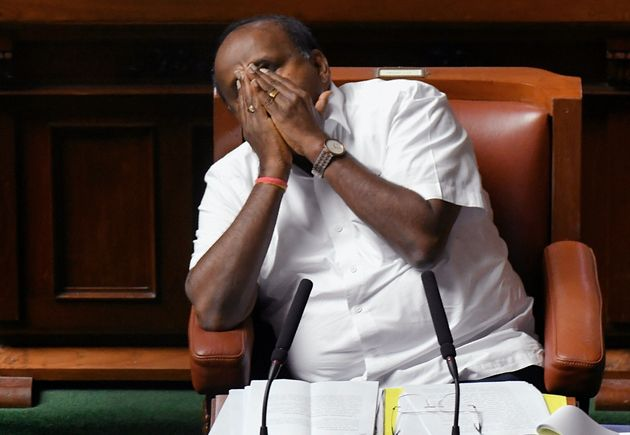 Chief Minister of Karnataka and senior Janatha Dal (Secular) leader Kumaraswamy yawns during the state...
