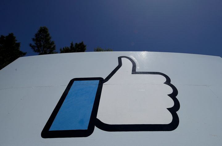 Facebook's thumbs-up Like logo is seen on a sign at Facebook's headquarters in Menlo Park, Calif.