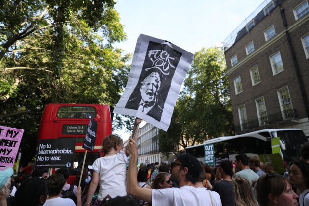 Protestors Target Boris Johnson On His First Day As PM
