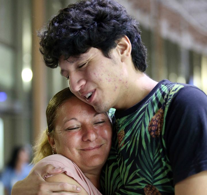 Francisco Galicia embraces his mother, Sanjuana Galicia, at the McAllen, Texas, Central Station, on Wednesday.