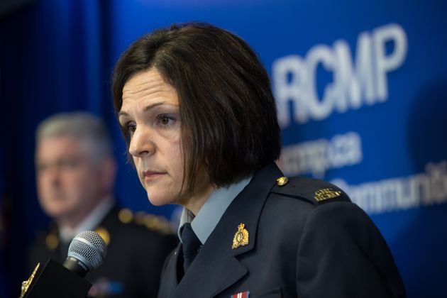 RCMP Sgt. Janelle Shoihet listens during a news conference in Surrey, B.C., on