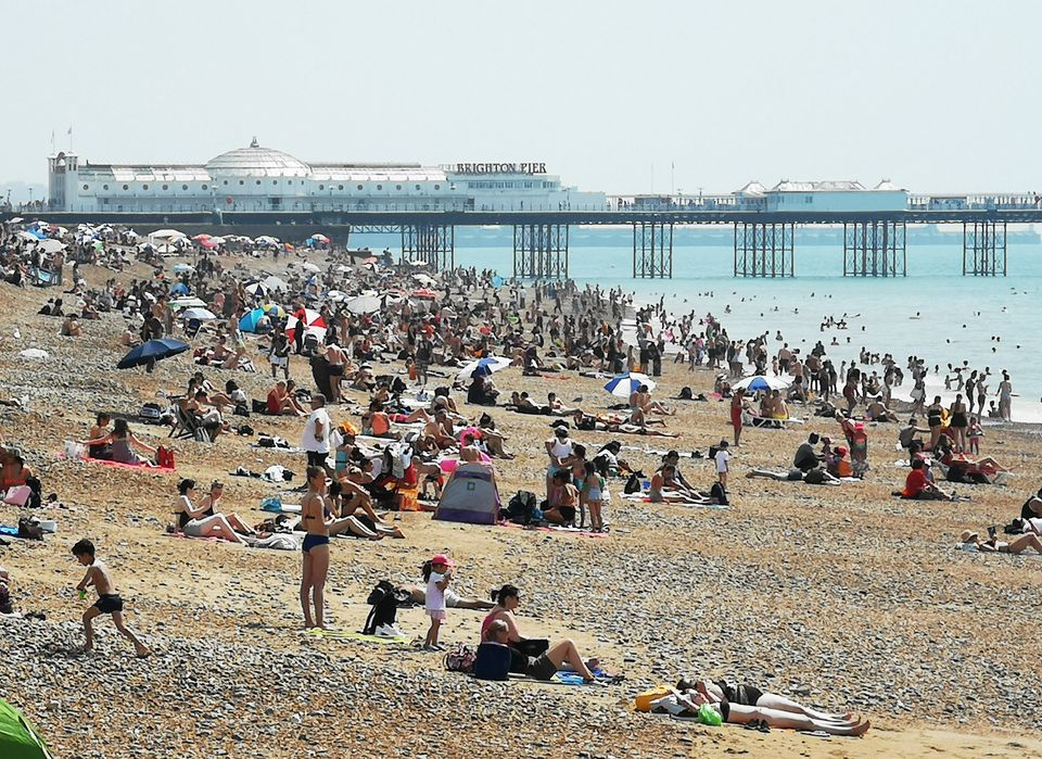 Basking in the hot weather on Brighton Beach on