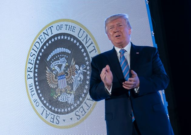 Donald Trump Stood In Front Of Presidential Seal Doctored With Russian Symbol, Golf