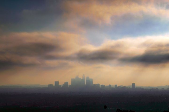 Downtown Los Angeles is seen shrouded in early morning coastal fog. Automakers and California recently launched private talks