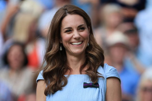 The Duchess of Cambridge laughs and smiles on Day 13 of The Championships - Wimbledon 2019 at the All...
