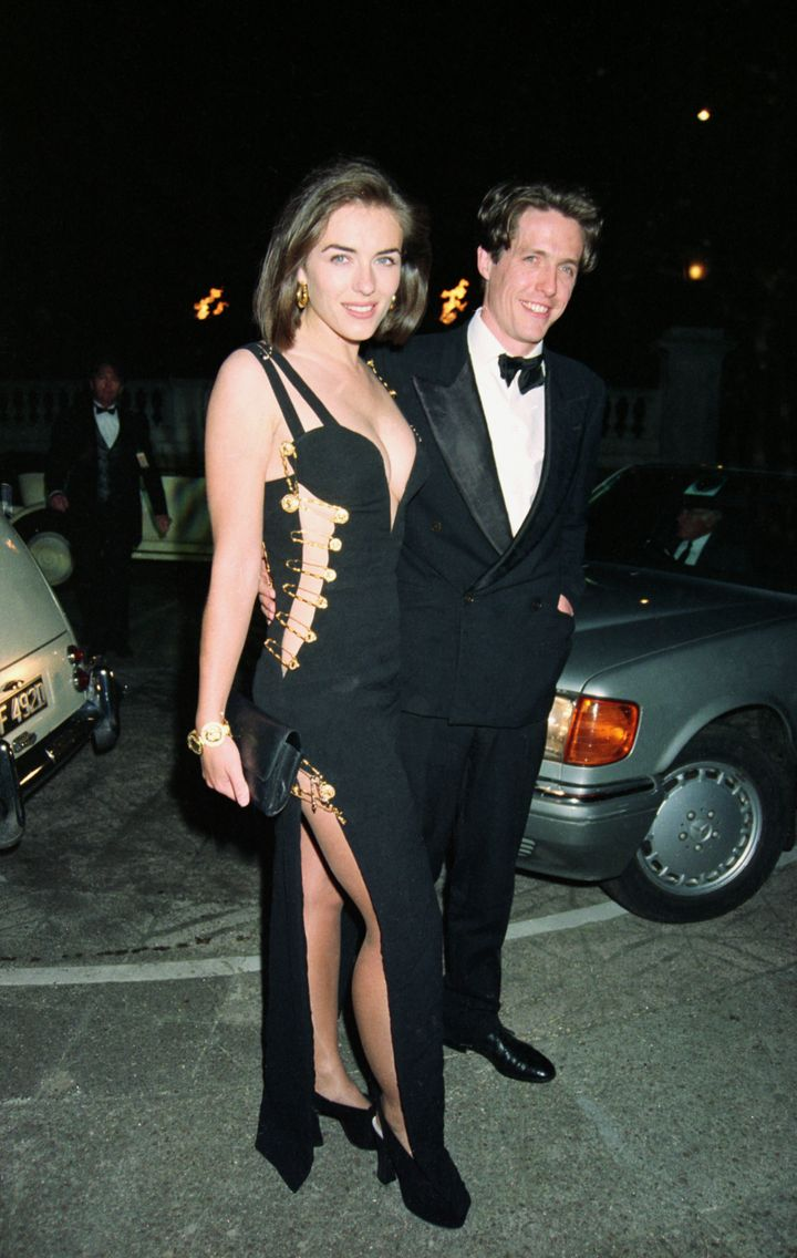 "Elizabeth Hurley and Hugh Grant arrive at the post-premiere party of ""Four Weddings and a Funeral"" in London on May 11, 1994."