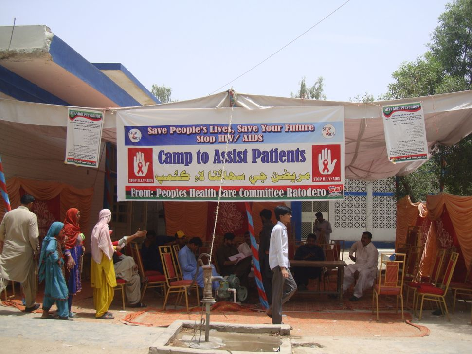 <i>A screening camp in Ratodero. HIV test kits, with results available within 30 minutes, are administered free of charge.</i