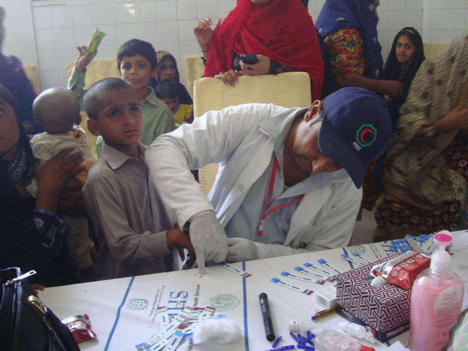 A child gets tested at a screening camp in Ratodero, Larkana District,
