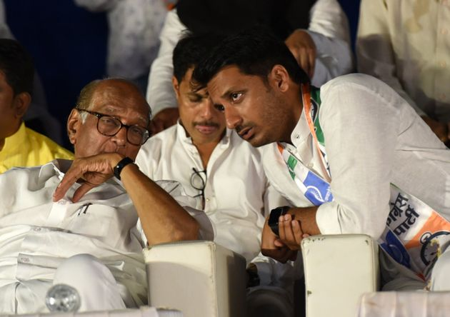 Parth Pawar with Sharad Pawar in a file