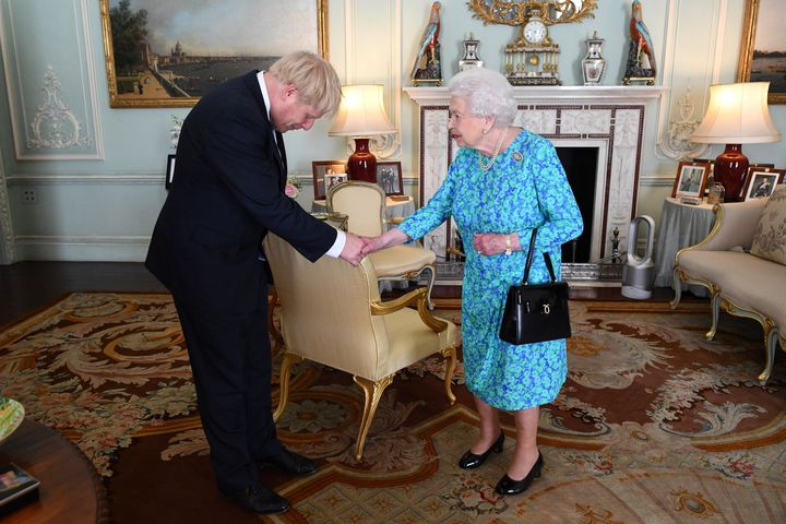 Boris Johnson greets Queen Elizabeth II.