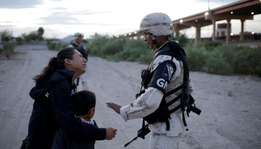 Haunting Photo Captures Guatemalan Mother Begging Soldier To Let Her Into