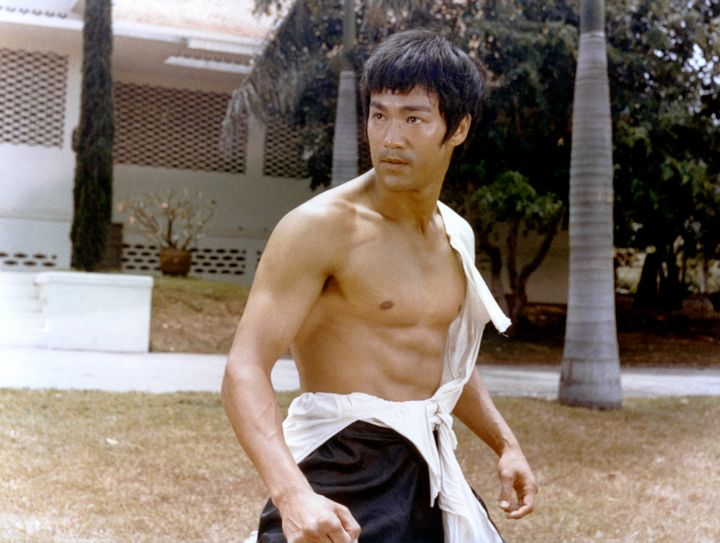 "A shirtless Lee on the set of ""Tang Shan Da Xiong"" (""Big Boss""), written and directed by Wei Lo."