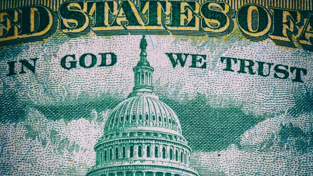 TORONTO, ONTARIO, CANADA - 2018/12/12: In God We Trust. Macro of a US dollar lettering in the back of a bank note. (Photo by Roberto Machado Noa/LightRocket via Getty Images)