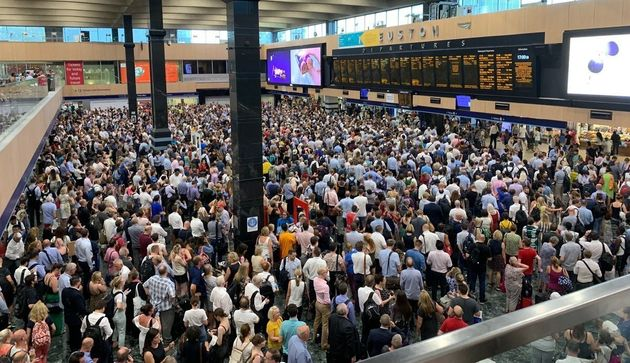 Crowds at Euston station in London, as commuters endured disruption on the railways as the UK sweltered...