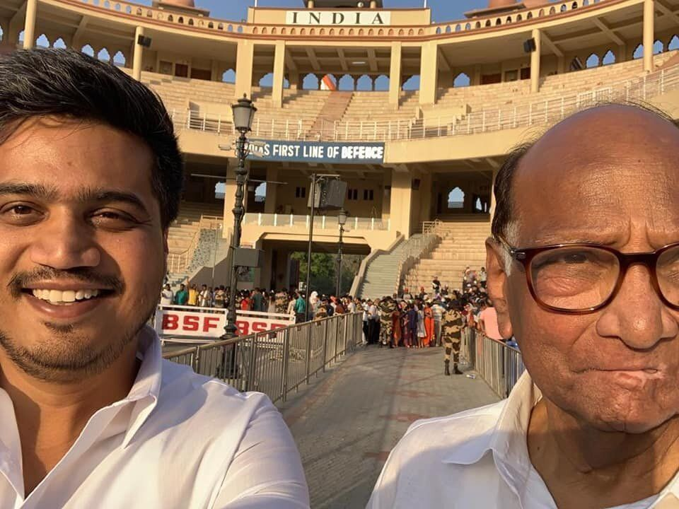 Rohit Pawar with his grandfather Sharad Pawar in a file