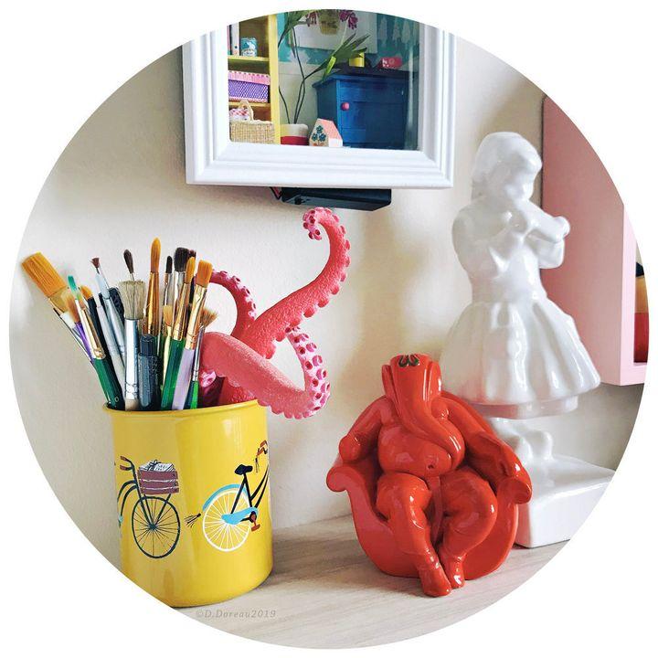 <i>Souvenirs de voyage : tentacules de Santa Monica, Ganesha de Goa, tartine bretonne par Henriette Porson.</i>