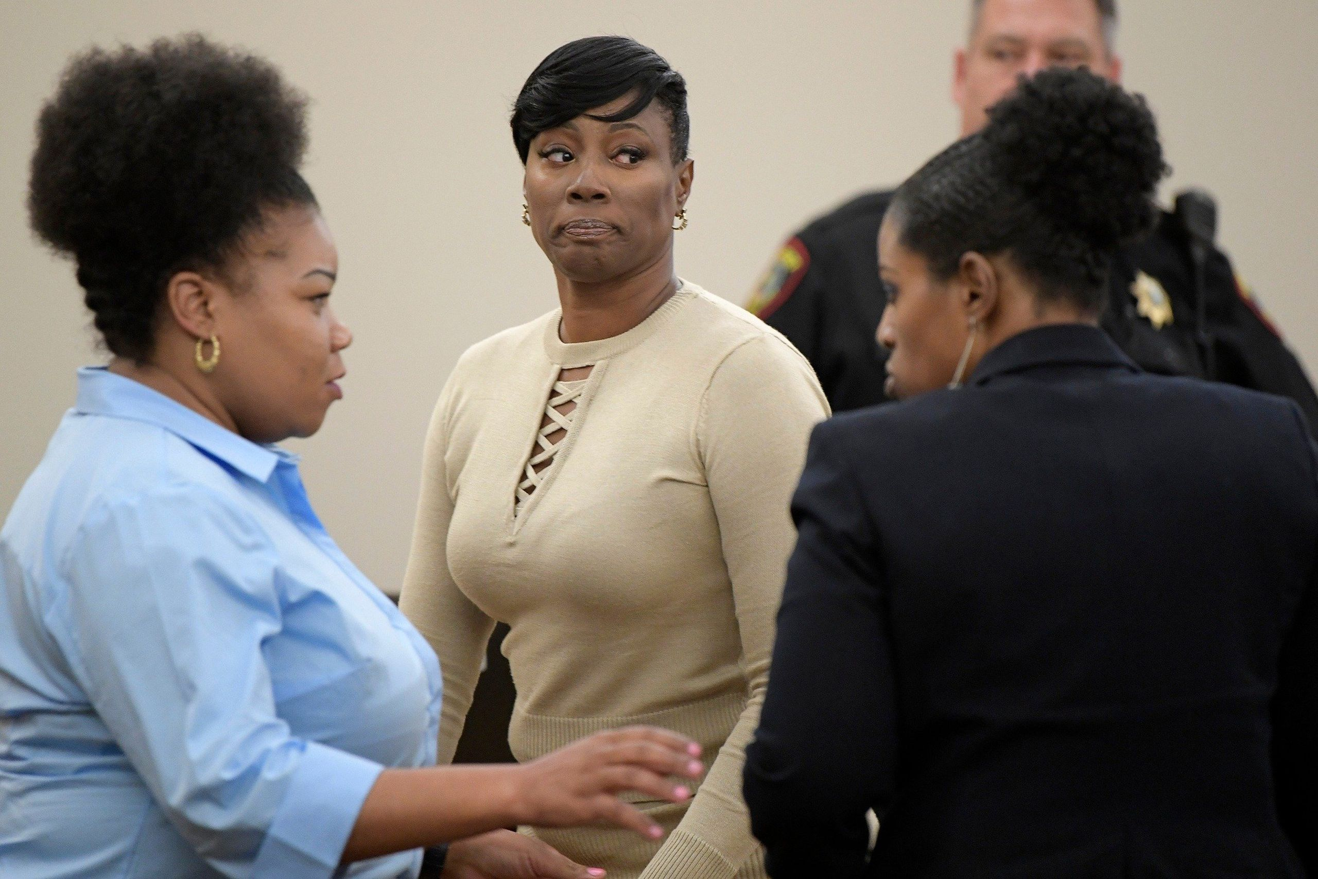 Crystal Mason, middle, during a break in Ruben Gonzalez's court at Tim Curry Justice Center in Fort Worth, Texas, on May 25,