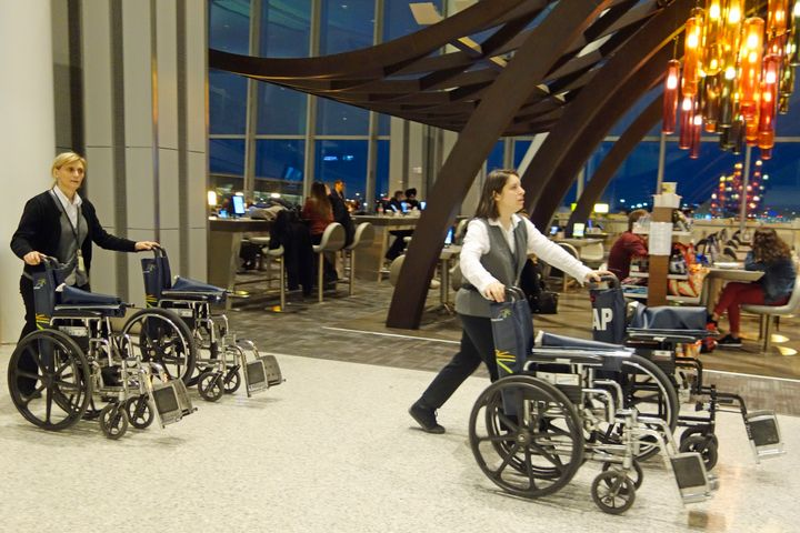 In this file photo, airport personnel manage wheelchairs at Toronto's Pearson International Airport.