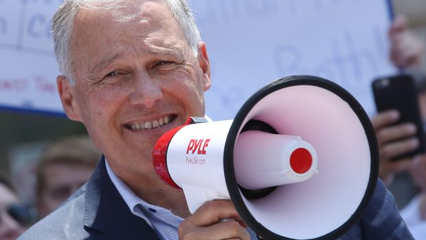 WASHINGTON, DC - JULY 12: Democratic presidential candidate Gov. Jay Inslee (WA), joins immigration activists to protest President Trump's immigration positions, family separation policy, and immigration raids planned for this weekend, in front of the U.S. Customs and Border Protection Headquarters on July 12, 2019 in Washington, DC.  (Photo by Mark Wilson/Getty Images)