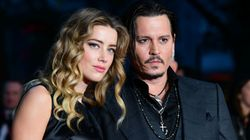 Amber Heard Denies Putting Out Cigarette On Johnny Depp's
