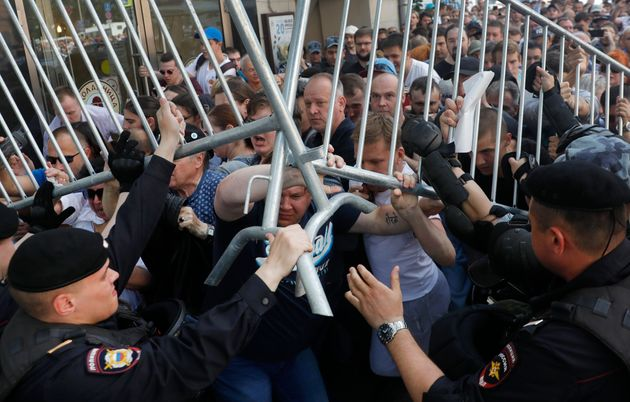 Protesters clash with police during an unsanctioned rally in the center of Moscow, Russia, Saturday,...