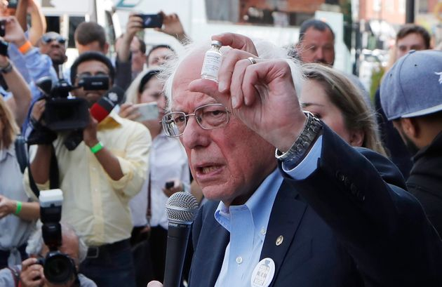 Sen. Bernie Sanders holds an insulin vial outside Olde Walkersville Pharmacy in Windsor, Ont. on July...