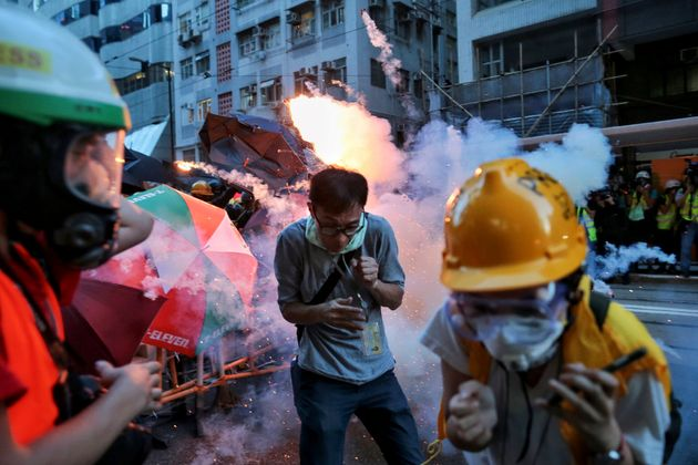 Hong Kong Protests: Police Fire Tear Gas As Protesters Block Roads