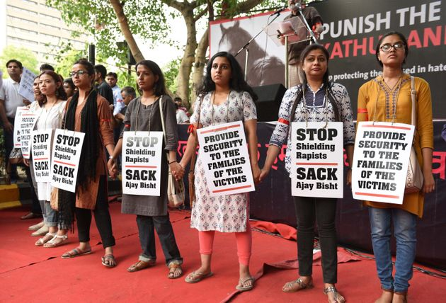 People take part in 'Not In My Name' protest against the Kathua and Unnao rape cases, at Parliament Street,...