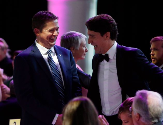 Prime Minister Justin Trudeau (right) shares a laugh with Conservative Leader Andrew Scheer as they attend...