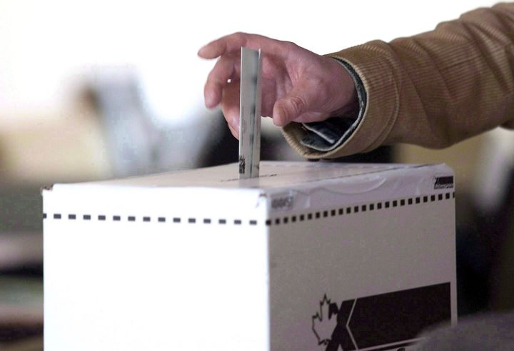 A voter casts a ballot in the 2011 federal election in Toronto on May 2, 2011.