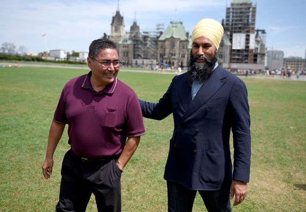 NDP Leader Jagmeet Singh walks with Chief Rudy Turtle of the Grassy Narrows First Nation on the lawn...