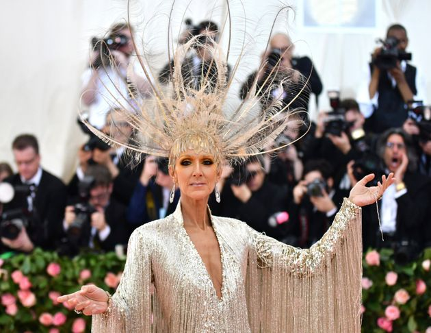 At the 2019 Met Gala, Céline Dion wore an Oscar de la Renta gown and a feathery headpiece that...