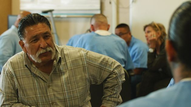 George Luna listening to an inmate during one of the small group breakouts during a GRIP