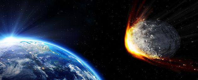 地球に衝突する小惑星のイメージ写真